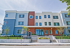 NEI General Contracting reconstructs 16 units destroyed by fire for Just-A-Start