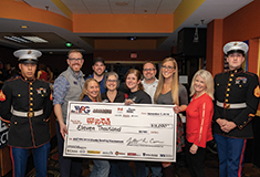 ABC NH/VT Young Professionals Group donates proceeds from charity bowling tournament to Toys for Tots