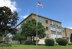 Stoll and Aron of Metrowest broker $2.6m sale of Marian High School