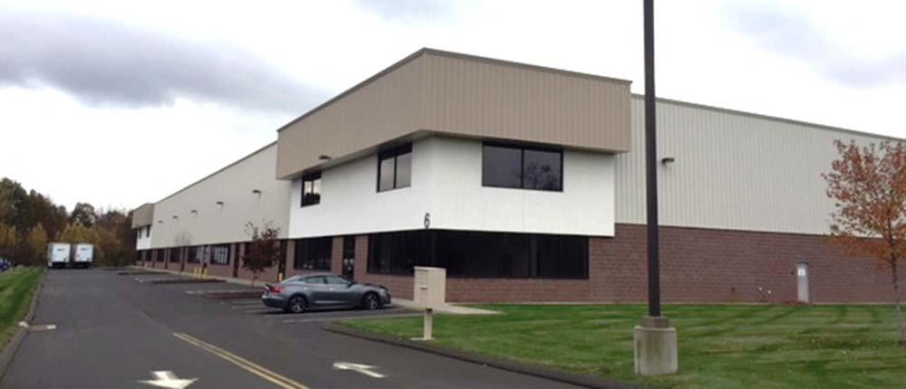 Barnes and Roberts of CBRE/NE and Damato of Press|Cuozzo handle 50,400 s/f building lease
