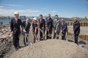 Shown (from left) are: Anthony Verzi, executive director of real estate banking at JP Morgan; Brian Golden, director of the Boston Redevelopment Authority; Abby Goldenfarb, vice president at Trinity Financial; Boston mayor Martin Walsh; Mass. governor Charlie Baker; state representative Adrian Madaro; Boston city councilor Sal LaMattina; Al Caldarelli, executive director of the East Boston Community Development Corp.