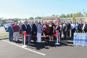 Waterstone and the city of Rochester celebrate the ribbon cutting at THE RIDGE Marketplace